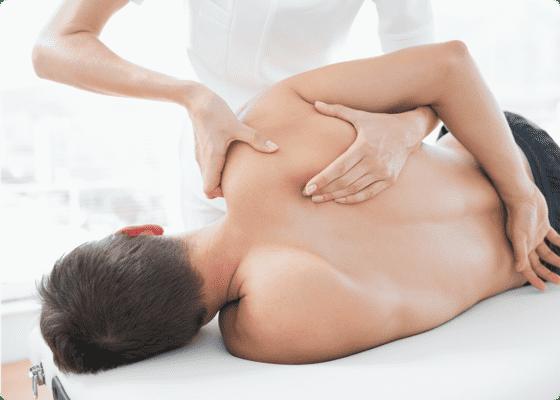 Hands massaging a man's back