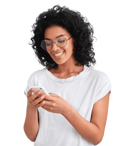 A woman in white top looking at her mobile