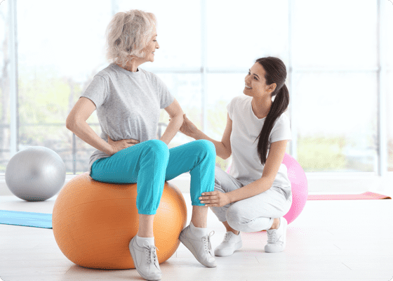 Two women talking in a yoga room
